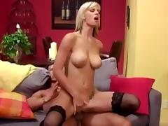 Blonde with black stockings fucks on red sofa tube porn video
