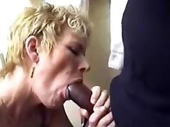 Aged golden-haired sucks and bonks her darksome paramour at home in her bedroom tube porn video