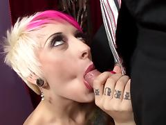 Tattooed punk with big boobs sucking a stranger's huge cock tube porn video