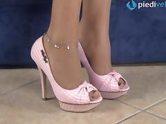 Tattooed brunette in stockings reveals her beautiful feet tube porn video