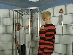 A MILF with a shaved head unchains her slave so he can fuck her tube porn video