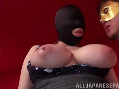 Big tits Asian in a mask moans while getting stroked with a toy tube porn video