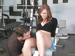 Redhead Dani Jensen in miniskirt is being banged Hardcore in the gym tube porn video