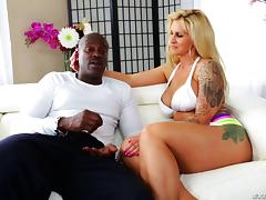 Tattooed blonde pornstar and her black stud get flirty in backstage interview tube porn video