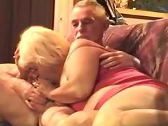 Grandma sucks grandpa's cock, while he watches tv. tube porn video