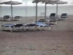 Milf sucks and jerks her man's cock at a beach on vacation tube porn video