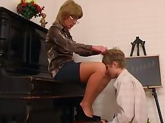 Older piano teacher dominates her student tube porn video