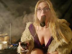 Smoking a huge cigar in a fur coat tube porn video