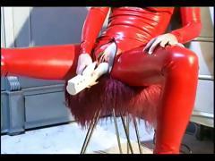 Tied up slave girl posing in latex tube porn video