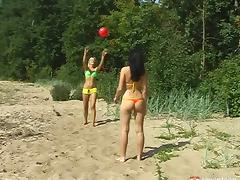 Babes enjoying their summer vacation by having sex on the beach tube porn video