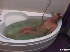 Nerdy blonde gets naked and takes a bath tube porn video