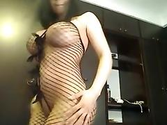 busty posing in bottomless fishnet catsuit tube porn video