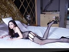 Slim girl in sexy lace bodystocking tube porn video