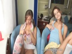 Two cuties pose on the sofa tube porn video