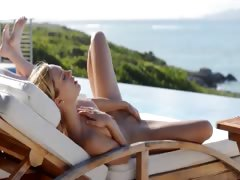 Blonde beauty Leila naked in the sun tube porn video
