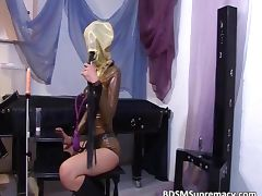 Kinky brunette slut gets in latex tube porn video