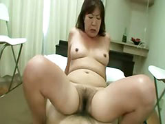 Oriental tramp gets her hairy pussy rocked on bed tube porn video