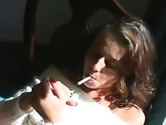 Penny Flame smokes in angora sweater tube porn video