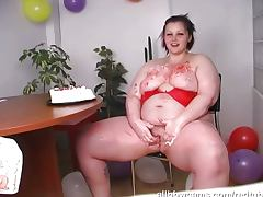 Big birthday girl masturbates with her cake tube porn video