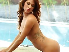 Sexy babe Mandie Sue takes her bright bikini off and poses for the cam tube porn video
