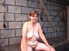 Old whore's filthy ass goes red from spiked glove spanking in dungeon tube porn video