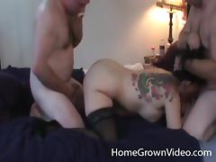 Tattooed girl in stockings sucks and fucks with two guys tube porn video