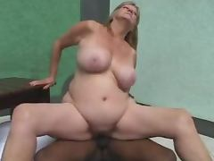 Mature blonde lets a hot ebony girl fuck her snatch with a strap on tube porn video