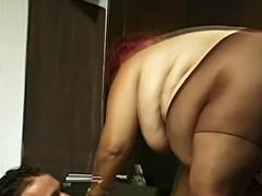 Unsightly chunky redhead sucks man's 10 Pounder and his balls with her giant breasts then bonks tube porn video