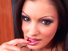 Glamorous business woman is posing on the table tube porn video