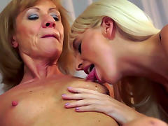 Kinky granny is fisting blondie's trimmed pussy tube porn video
