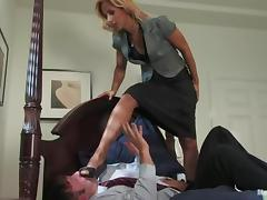 Hot office chick ties her boss up and tortures him in a bedroom tube porn video