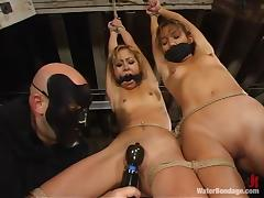 Kat and Keeani Lei get bound and tormented in a basement tube porn video