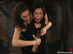 Ariel X moans sweetly while getting say no to holes toyed in a basement tube porn video