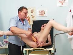 Bella Karina is lying in her lovely med chair tube porn video