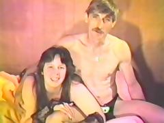 Chubby brunette milf sucks her man's dick in a vintage video tube porn video