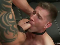 A guy in a suit gets tied up and fucked by bad biker tube porn video