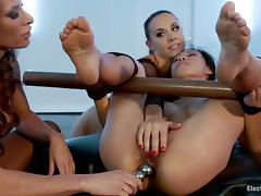 Smoking hot Asian sex slave is given to these mistresses in fishnet tube porn video