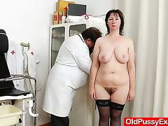 Spiky-looking housewife getting a gyno tube porn video