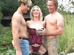 Two fuckers are drilling this slutty blonde tube porn video