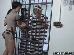 Sexy and bitchy prison guard entertains two convicts tube porn video