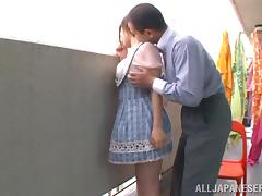 He makes her Japanese chick squirt on the balcony tube porn video