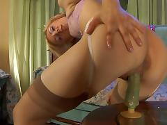 Heated babe puts on suntan stockings getting ready for her solo dildo... tube porn video