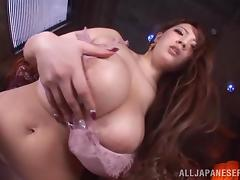 Well-endowed Japanese milf fingers her shaved coochie in solo clip tube porn video