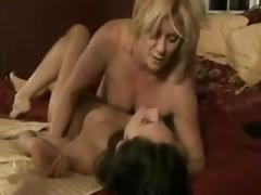 Blond MILF tryes a dark haired girl. tube porn video