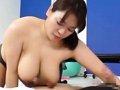 Mizuki Ann rubs cocks with huge assets tube porn video