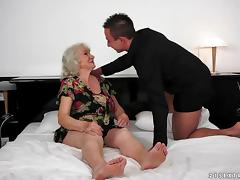 A BBW granny cums as a younger guy drills her vintage, hairy pussy tube porn video
